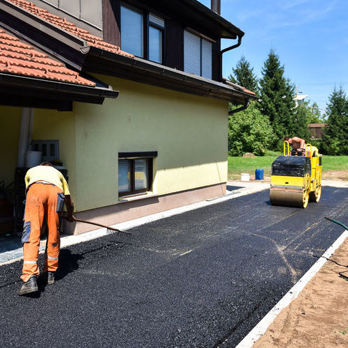An Asphalt Drive Gets Resurfaced.