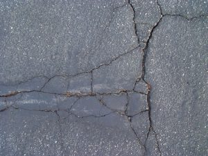 An Up Close Picture of Damaged Asphalt Surface