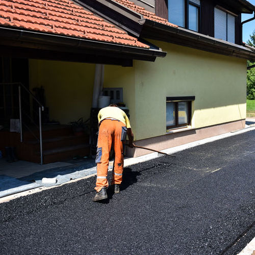 Contractor Working on Asphalt Patch
